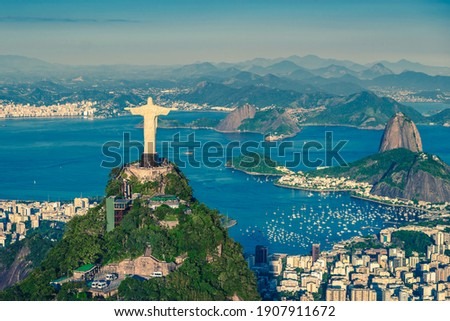 Aerial helicopter panorama of Botafogo Bay with Christ and Sugar Loaf Mountain in Rio de Janeiro, Brazil Royalty-Free Stock Photo #1907911672
