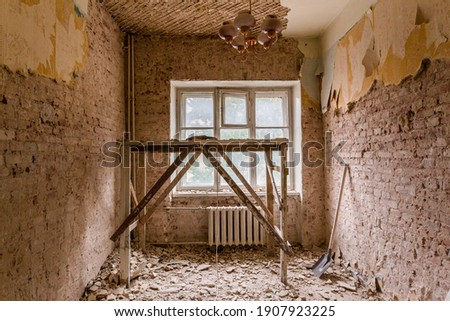 Dismantling in the old apartment before new renovation, construction concept Royalty-Free Stock Photo #1907923225