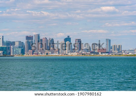 Boston financial district modern city skyline and Logan International Airport by the sea from Deer Island, Boston, Massachusetts MA, USA.