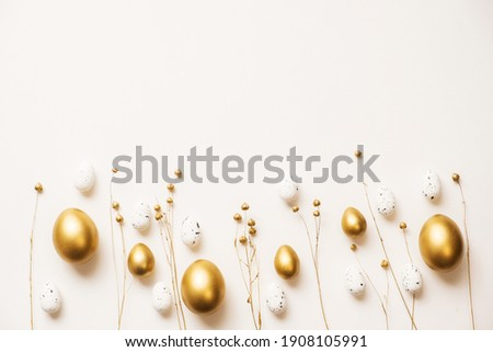 Stylish golden eggs easter concept. Easter gold eggs with golden dried flax linum bunch white background. Flat lay trendy easter. Happy easter card. Copy space for text Royalty-Free Stock Photo #1908105991