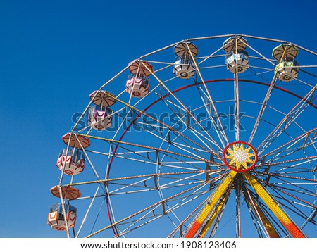 A closeup of a colorful Ferris wheel in the amusement Royalty-Free Stock Photo #1908123406