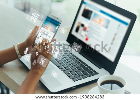 Businesswoman phone and laptop using , online shopping concept. Royalty-Free Stock Photo #1908264283