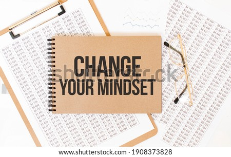 Craft colour notepad with text Change Your Mindset. Notepad with eyeglasses and text documents. Business concept