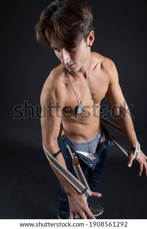 Studio portrait of a muscular built italian young man. Royalty-Free Stock Photo #1908561292