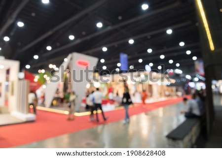 Abstract blur people in exhibition hall event trade show expo background. Large international exhibition, convention center, business marketing and event fair organizer concept. Royalty-Free Stock Photo #1908628408