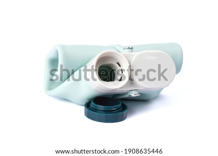 Silicone water bottle isolated on white background. Collapsible Eco friendly bottle. Photography for design Royalty-Free Stock Photo #1908635446