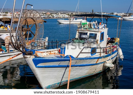 Fishing boats in Paphos Harbour Cyprus which is a popular travel destination attraction landmark of the Mediterranean island tourist resort, stock photo image Royalty-Free Stock Photo #1908679411
