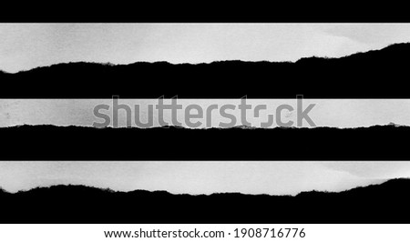 Ripped black and white paper, copy space. Royalty-Free Stock Photo #1908716776