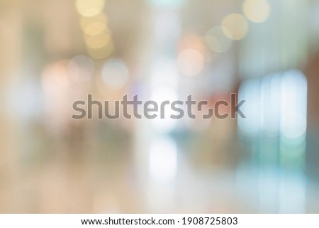abstract blur image background of shopping mall with light bokeh and flare light bulb Royalty-Free Stock Photo #1908725803