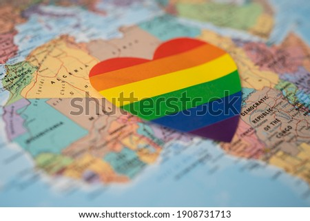 Rainbow color heart on Africa globe world map background, symbol of LGBT pride month  celebrate annual in June social, symbol of gay, lesbian, bisexual, transgender, human rights and peace.
