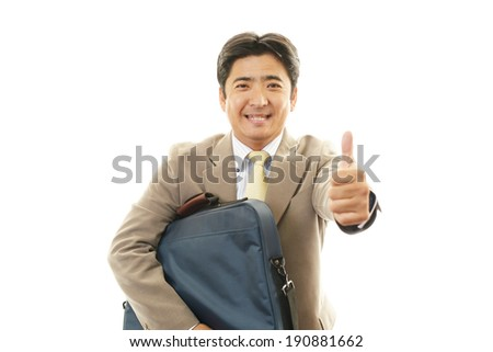 Asian business man showing thumbs up sign #190881662