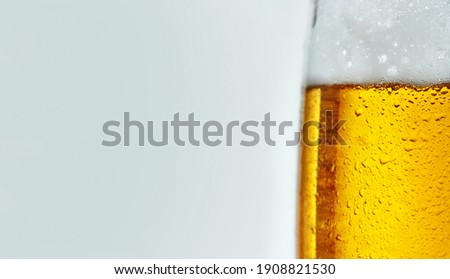 panoramic picture with part of a glass of beer