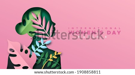 Happy Women Day greeting card illustration. 3D papercut female silhouette with beautiful tropical nature decoration and pink plant leaf. Cute paper craft design for international women's event. Royalty-Free Stock Photo #1908858811