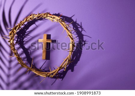 Lent season, Holy week and Good friday concept. Crown of torns and cross on purple background