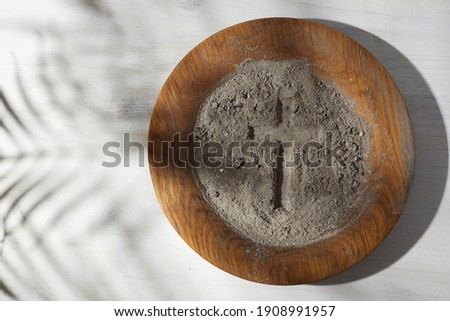 Ash wednesday, crucifix made of ash, dust as christian religion. Lent beginning Royalty-Free Stock Photo #1908991957
