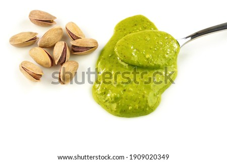 So delicious pistachio paste or pistachio nut butter. Turkish breakfast dessert. Macro image on white background.                  Royalty-Free Stock Photo #1909020349