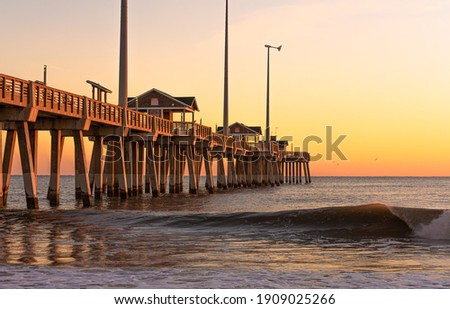Jennette's Fishing Pier in Nags Head North Carolina at sunrise. Royalty-Free Stock Photo #1909025266