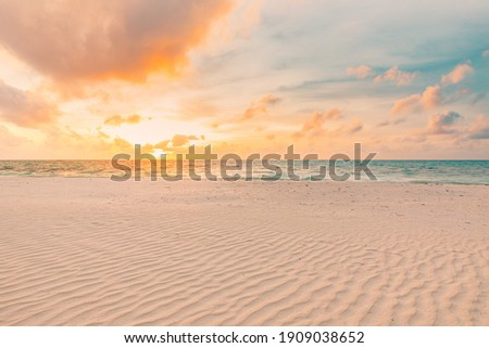 Closeup sea sand beach. Panoramic beach landscape. Inspire tropical beach seascape horizon. Orange and golden sunset sky calmness tranquil relaxing sunlight summer mood. Vacation travel holiday banner Royalty-Free Stock Photo #1909038652