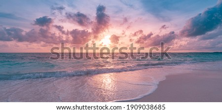 Closeup sea sand beach. Panoramic beach landscape. Inspire tropical beach seascape horizon. Orange and golden sunset sky calmness tranquil relaxing sunlight summer mood. Vacation travel holiday banner Royalty-Free Stock Photo #1909038685
