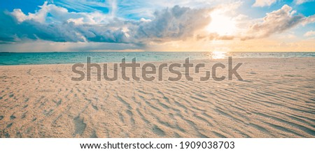Closeup sea sand beach. Panoramic beach landscape. Inspire tropical beach seascape horizon. Orange and golden sunset sky calmness tranquil relaxing sunlight summer mood. Vacation travel holiday banner Royalty-Free Stock Photo #1909038703