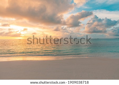 Closeup sea sand beach. Panoramic beach landscape. Inspire tropical beach seascape horizon. Orange and golden sunset sky calmness tranquil relaxing sunlight summer mood. Vacation travel holiday banner Royalty-Free Stock Photo #1909038718