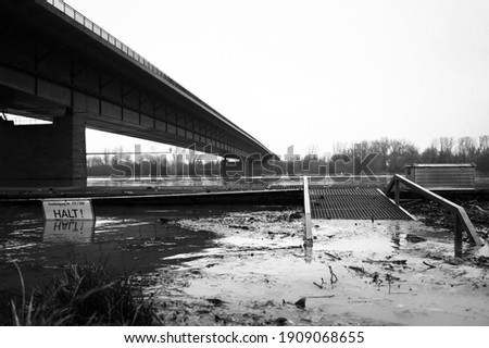 Germany Mainz: Floods  of the Rhine due to natural disaster or climate change. The picture shows the Weisenauer Bridge. Black and white image.