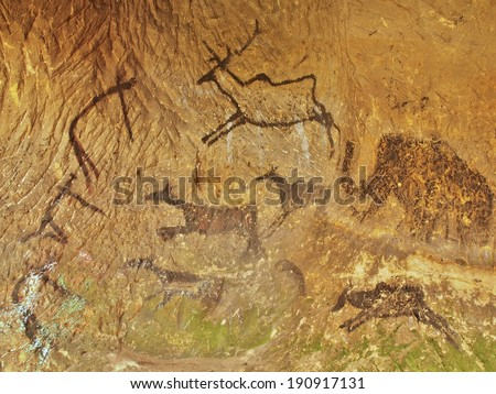 Abstract children art in sandstone cave. Black carbon paint of human hunting on sandstone wall, copy of prehistoric picture. Caveman draw in cave. Mammoth draw in cave.