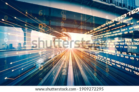 Digital data flow on road with motion blur to create vision of fast speed transfer . Concept of future digital transformation , disruptive innovation and agile business methodology . Royalty-Free Stock Photo #1909272295