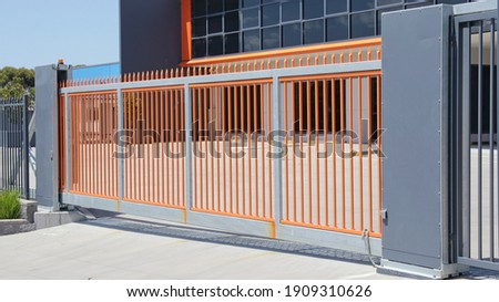 Large automatic commercial sliding gate Royalty-Free Stock Photo #1909310626