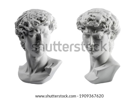 Gypsum statue of David's head. Michelangelo's David statue plaster copy isolated on white background. Ancient greek sculpture, statue of hero. Royalty-Free Stock Photo #1909367620