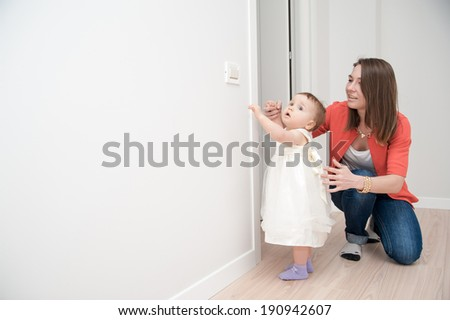 The girl is having fun with a little princess in a white dress