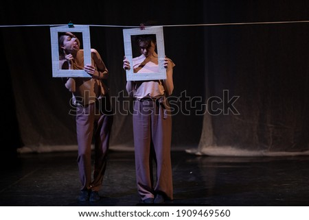 Actors and actresses play a modern lyrical performance of the theater stage show Royalty-Free Stock Photo #1909469560