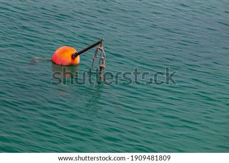 Red boat mooring buoy, European marina nautical equipment Royalty-Free Stock Photo #1909481809