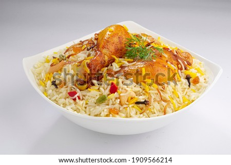 Chicken biryani , kerala style chicken dhum biriyani made using jeera rice and spices arranged in a white ceramic table ware with white background, isolated Royalty-Free Stock Photo #1909566214