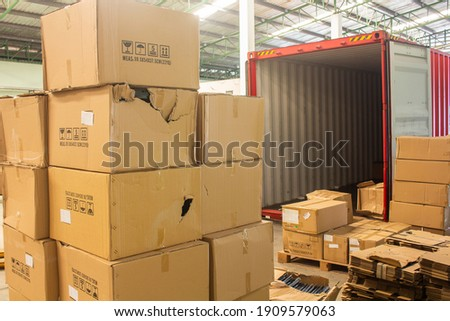 unloading carton from container and carton damage from loading or transport process.  Royalty-Free Stock Photo #1909579063