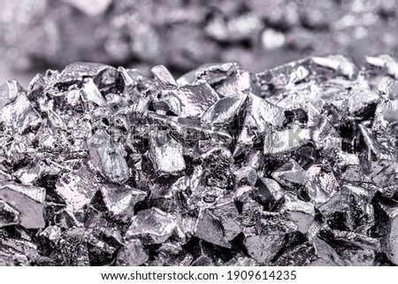 titanium metal alloy, used in the industry, titanium is a transition metal that adds value to metal alloys because it is light and resistant Royalty-Free Stock Photo #1909614235