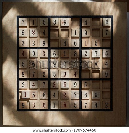 Numbers sudoku puzzle game board stock photo with sunligths and shadows. High quality photo