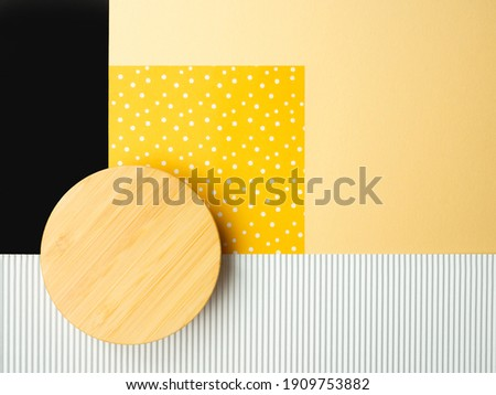 Abstract flatlay,close up top view round wooden mock up overlay paper piece.Yellow square white polka dot,black rectangle,corrugated cardboard stripe on beige backdrop.design pattern copy space.
