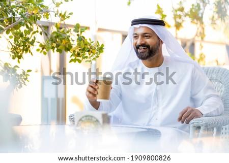 Middle Eastern Arab Emirati man at the Cafe in Dubai, United Arab Emirates Royalty-Free Stock Photo #1909800826