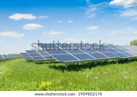 Solar panels and blue sky. Solar panels system power generators from sun. Clean technology for better future Royalty-Free Stock Photo #1909802176