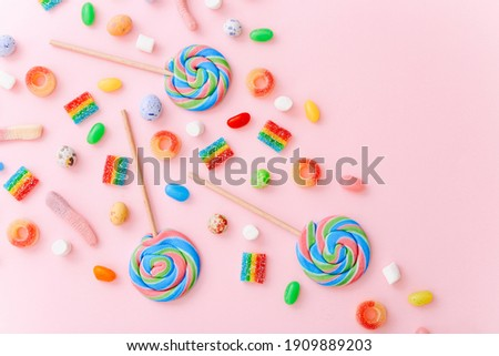 Mixed collection of colorful candy, on pink background. Flat lay, top view Royalty-Free Stock Photo #1909889203