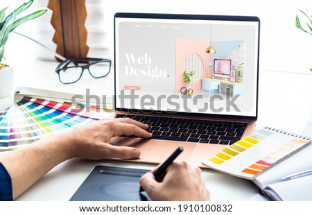 Web design desktop with  laptop and tools