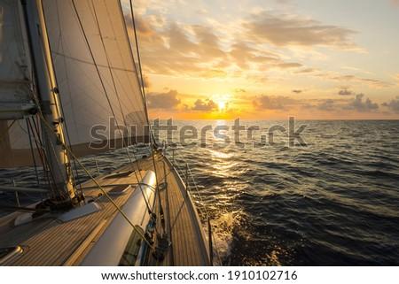 Sailboat sailing in the Mediterranean Sea at sunset Royalty-Free Stock Photo #1910102716