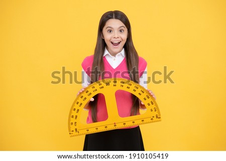 School education. stem disciplines. concept of education. measuring and sizing. height of child. surprised girl with protractor ruler. back to school. trigonometry stationery. kid study mathematics.