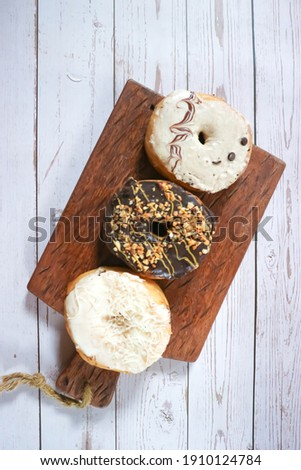 Unfocus picture of many pieces of Donat Kentang Asia,Picture of Asian Assorted Donuts with Chocolate frosted,Chocolate glazed, Cheese, Icing Sugar and Sprinkles Donuts. Isolated on white Background