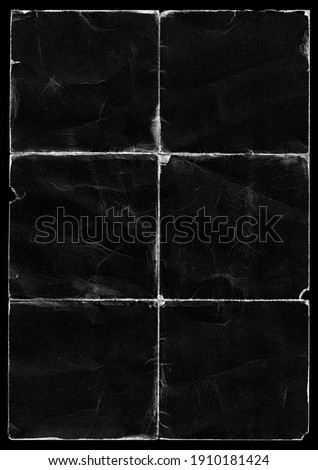Old Black Empty Ripped Folded Torn Cardboard Paper Poster. Grunge Scratched Old Shabby Surface. Distressed Overlay Texture for Collage.   Royalty-Free Stock Photo #1910181424
