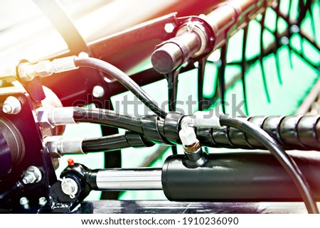 Hydraulic hoses and cylinders of the machine mechanism Royalty-Free Stock Photo #1910236090