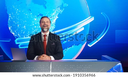 Live News Studio with Charismatic Male Newscaster Having Fun. Talk Show Host Telling Joke and Laughing. TV Broadcasting Channel with Presenter, Anchor Talking. Mock-up Television Channel Newsroom Set