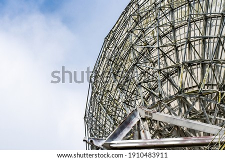 Huge satellite antenna dish for communication and signal reception out of the planet Earth. Observatory searching for radio signal in space at sunset. Royalty-Free Stock Photo #1910483911