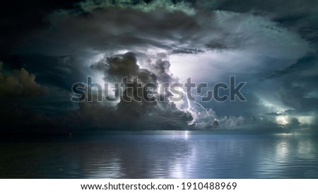 The perfect mushroom cloud storm over the sea Royalty-Free Stock Photo #1910488969